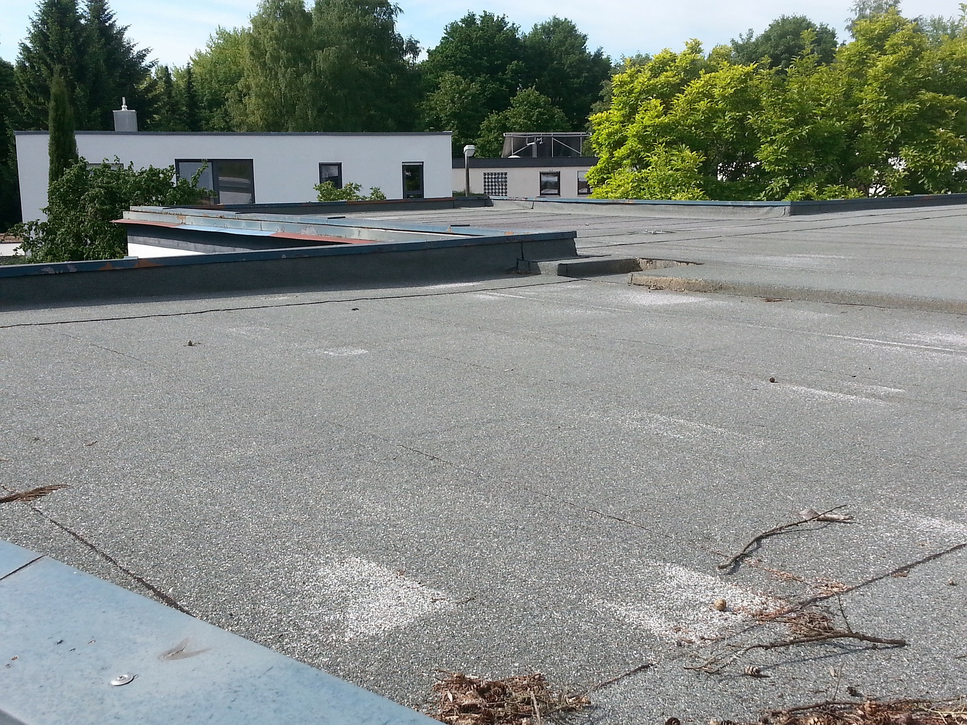 Ponding On Your Flat Roof Is It Acceptable Avery Roof Services